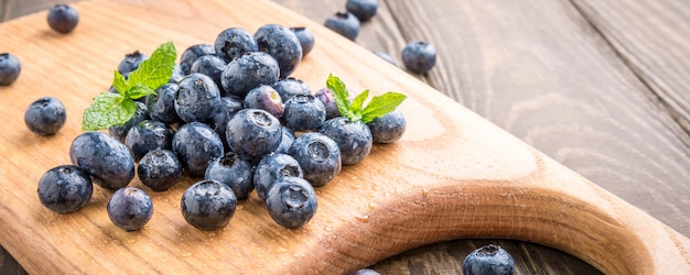 Freshly picked blueberries on wooden board
