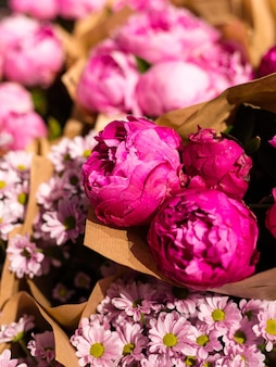 Freshly picked bouquet of peony flowers at the farmers market