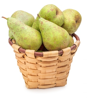Freshly picked raw green pears from the tree in wicker basket.