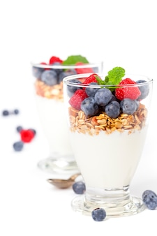 Freshly prepared yogurt parfait with fresh fruit and mint