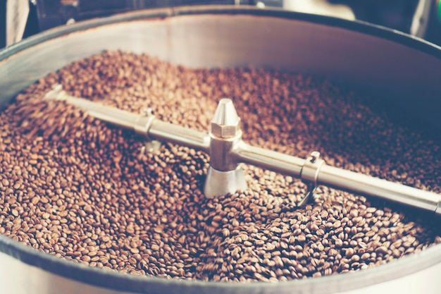 Freshly roasted aromatic coffee beans in a modern coffee roasting machine