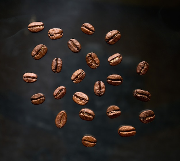 Freshly roasted coffee beans on a gray abstract background