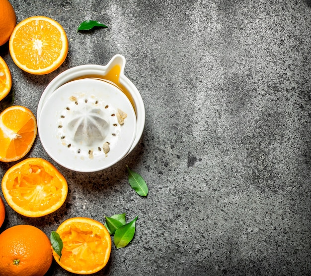 Freshly squeezed orange juice with pieces of fruit . on rustic background.