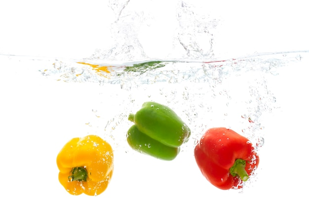 Freshness vegetable red yellow and green pepper fruit with water splash white background.