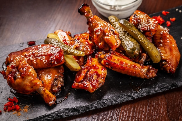 Fried american chicken wings barbecue in glaze sauce.