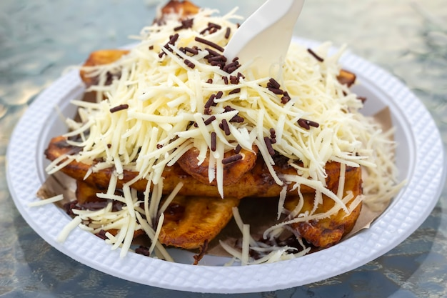 Fried banana with chocolate and cheese on the table