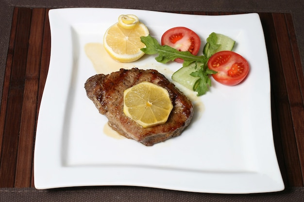 The fried beef in lemon juice with vegetables