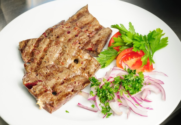 Fried beef liver with vegetables