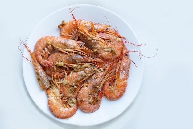 Fried big prawns on a white plate