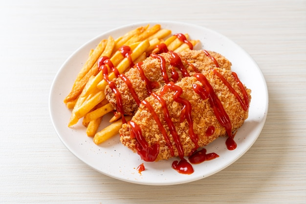 Fried chicken breast fillet steak with french fries and ketchup