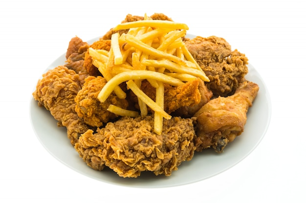 Fried chicken and french fries in white plate