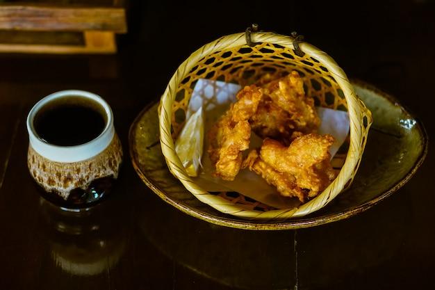 Fried chicken karaage in a bamboo basket