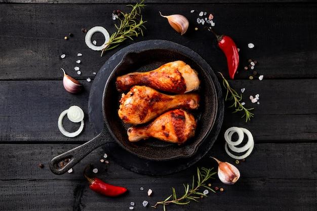 Fried chicken legs in a cast iron pan