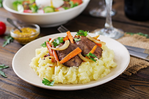 Fried chicken liver with vegetables and garnish of mashed potatoes. healthy food