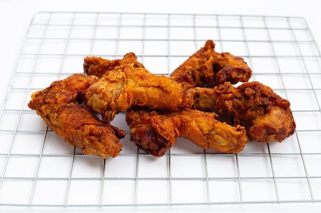 Fried chicken necks on white background.
