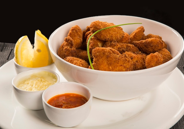 Fried chicken nuggets and lemon and peppers sauce