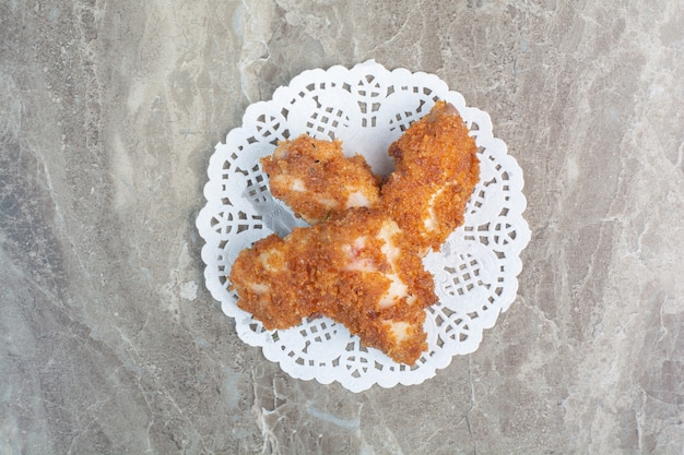 Fried chicken nuggets on marble background