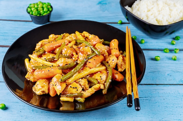 Fried chicken teriyaki with sweet and sour sauce