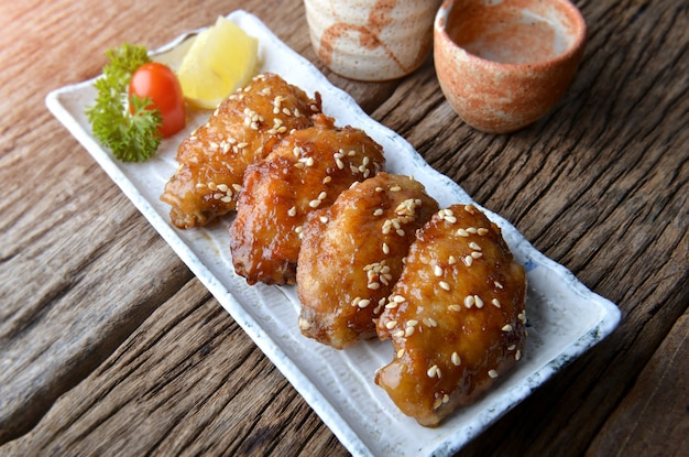 Fried chicken wing with spicy sauce in japanese style.