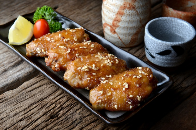 Fried chicken wing with spicy sauce in japanese tebasaki style.