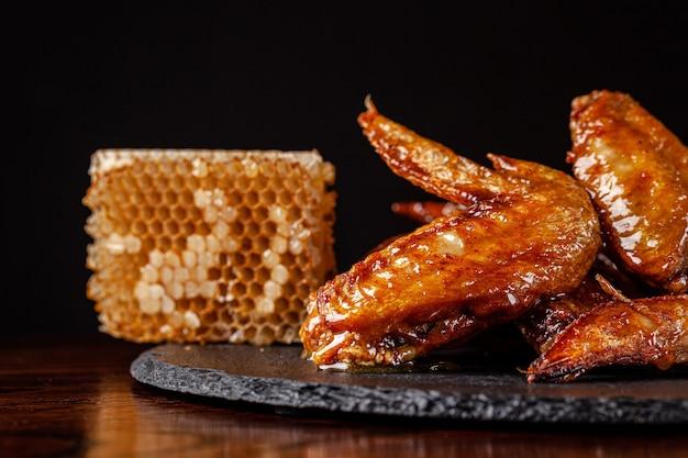 Fried chicken wings glazed in honey sauce