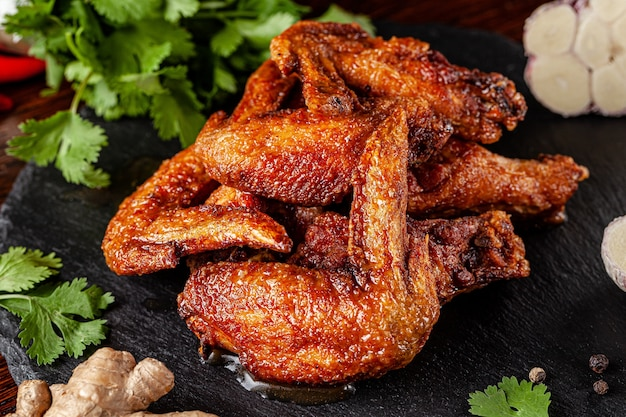 Fried chicken wings glazed in marinated