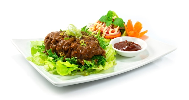 Fried chicken with curry sauce japanese food style served tomato sauce and salad vegetables sideview