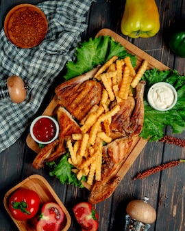 Fried chicken with french fries, ketchup, mayonnaise, and lettuce