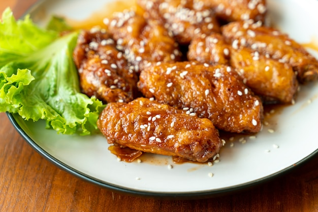 Fried chicken with korean spicy sauce and white sesame