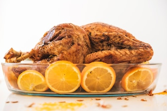 Fried chicken with oranges on table