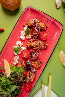 Fried chicken with sesame and sauce