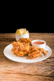 Fried chicken on the wooden table