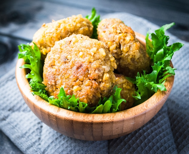 Fried chickpea falafel and leaves of green salad