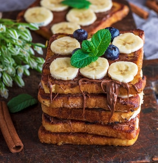 Fried chocolate french toasts with pieces of bananas