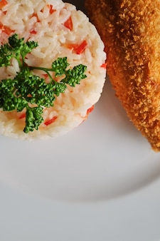 Fried chop with served with steamed rice - top view bright lighting