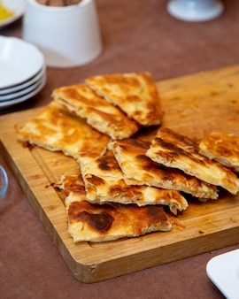 Fried crepes on wooden board