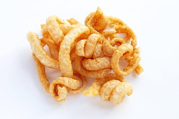 Fried crispy pork rinds on white background.