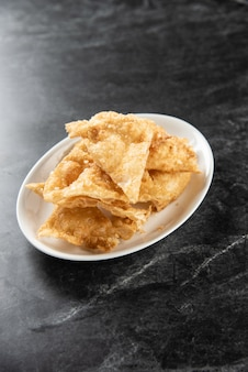 Fried crispy roti dough , crispy roti indian food made of flour on dish