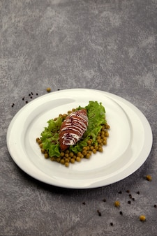 Fried cutlet with green peas