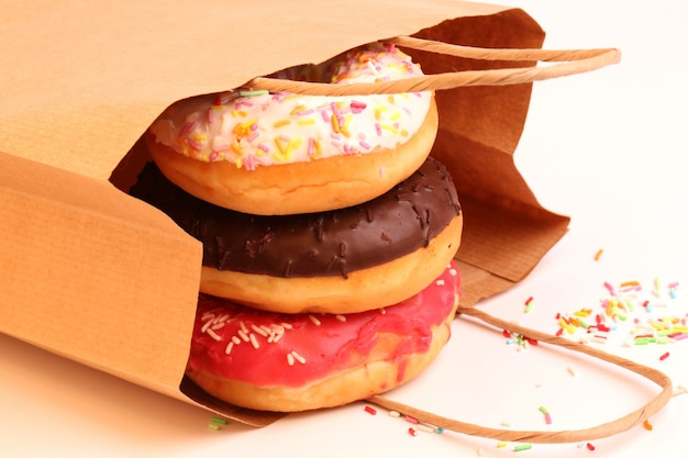 Fried donuts in a paper shopping bags