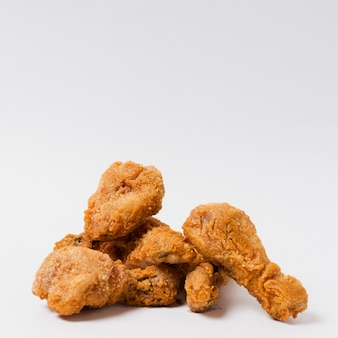 Fried drumsticks on white table