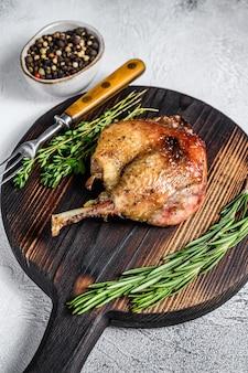 Fried duck confit leg baked poultry meat