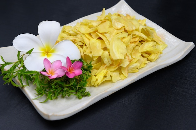 Fried durian in dish on table