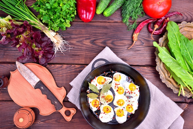 Fried egg and fresh vegetables and herbs