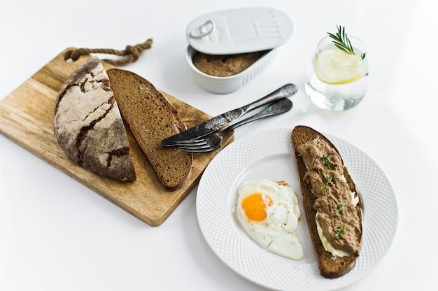 Fried egg, liver pate on bread