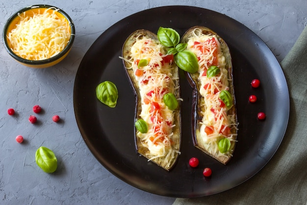 Fried eggplant stuffed with tomatoes grated cheese yogurt dressing and cranberries on the plate