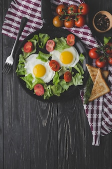 Fried eggs and salad for breakfast
