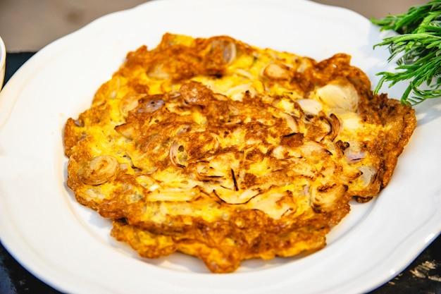 Fried eggs burn in a food dish