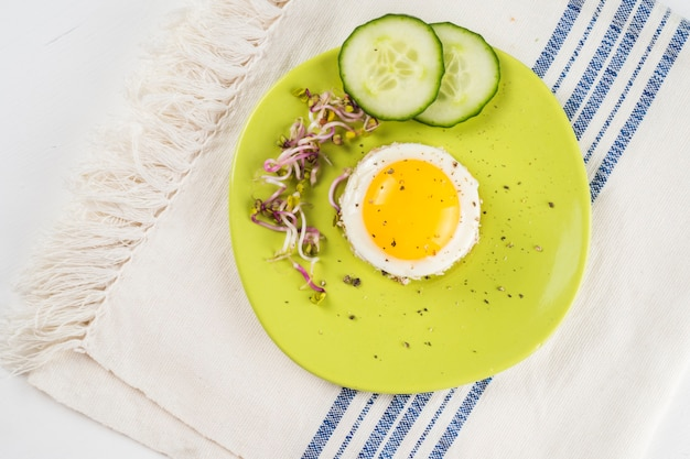 Fried eggs with cucumber