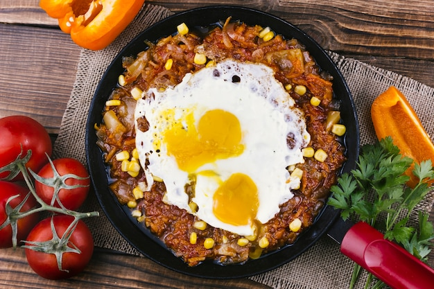 Fried eggs with mexican food in a pan
